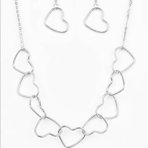 Silver necklace, earrings and bracelet
